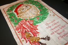 """Vintage Linen Tea Towel Wall Hanging Santa Wreath Dickens Quote  """" It is good to be children sometimes, and never better than at Christmas"""" by AstridsPastTimes on Etsy"""