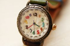 Vintage watch with hand-stitched face by Metal et Linnen $180