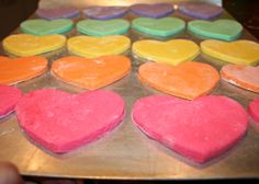 Colored Salt Dough Hearts <3   2C flour, 1C Water, 1C Salt, Food Coloring Heat oven to 250*, Mix salt, water & flour Separate dough into balls and knead in a few drops of food coloring into each. Use straw to make hole for ribbon so can hang.  Bake 1-2 hr until hearts are hard.