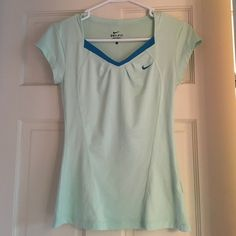 Nike Dri-fit Tennis Shirt Dri-fit, mint green tennis shirt with blue collar/Nike logo. Perforated upper back for air flow, small pleating on front chest area. Stylish Nike active wear. Excellent quality/condition. Great shirt, but not something I ever use for my workouts Nike Tops Tees - Short Sleeve