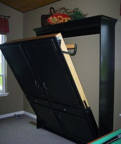 DIY Murphy Bed  MATERIALS  - Spring mechanism  - Wood (to measurements)  - Crown molding  - Cabinet hardware  - Paint and primer  - Paintbrush  - Mattress