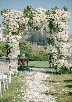 Amazing white floral arch for ceremony backdrop