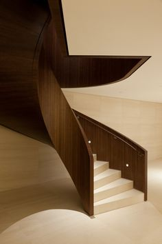 Sculptural wood and stone staircase inside the Bic Banco Headquarters in Sao Paolo by Kiko Salomão.