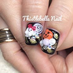Pin for Later: 102 Halloween Nail Art Ideas That Are Better Than Your Costume Adorable Apparition