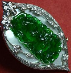 Imperial green jadeite plaque on mother of pearl, has a weight of 500 cts with a price of $14,000-$16,000/carat. Superb quality jadeite gemstones are selling for today, which is around $20,000 per carat.