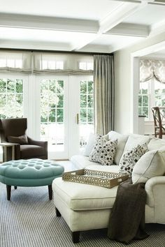 Like the color scheme brown chair, white sofa, gray