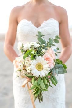 The perfect beach bouquet: Photography : Sylvia Guardia Read More on SMP: http://www.stylemepretty.com/destination-weddings/costa-rica-weddings/2016/07/21/costa-ricas-natural-beauty-meant-magic-for-this-intimate-destination-wedding/