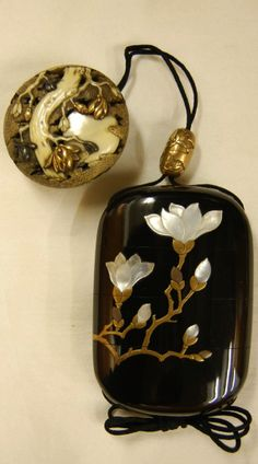 Magnolia blossoms. Japanese netsuke (manju) made of carved ivory; also silver, gold., via Takeshi Shiga