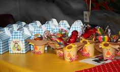 Wizard of Oz birthday favors.  gingham boxes and scarecrow's