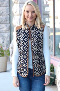 Tribal print puffer vest with suede shoulders. Perfect for wearing over your favorite basics! Camel suede and piping. Two front zipper pockets.