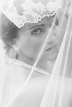 bridal portrait looking through veil
