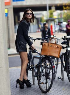 Olivia Palermo//Birkin bag// A whole new level of fashionable bike riding..But what about those heels?