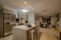 Kitchen and meals area. Great use of mixing light colours with the kitchen cabinets.