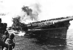 USS Franklin nicknamed Big Ben lists after getting bombed battered bruised and bent but not broken begins 12000 mile journey home under her own power in 1945 Us Navy Aircraft, Navy Aircraft Carrier, Hiroshima, Essex Class, Historia Universal, Powerful Pictures, Ww2 Photos, Photographs, Chur