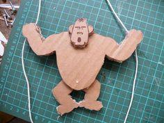 climbing cardboard gorilla toy