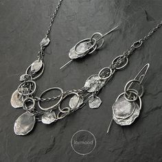 Earrings are made of oxidized silver 925 Dimensions: Single earrings weight : 3,5 g The whole length: 1.97 (5 cm) Silver elements diameter : 0.39 - 0.79 ( 10-20mm) In our offer you can find necklace to the set (picture no.4)  READY TO SHIP  We pack all the items in corporate boxes (visible in some offers). We ship all the consignments as priority registered consignments in well protected cartons.  Thank you for visiting