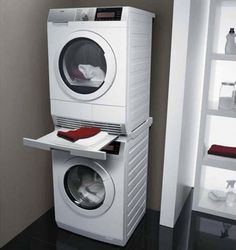 Stacked washer dryer with folding shelf between tiff for Colonna lavatrice asciugatrice ikea