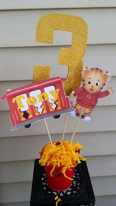3 Tiger figures in stick great for personalized centerpiece.