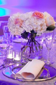 A table centerpiece with roses and hydrangea add sweet romance to this glamorous wedding reception! {Tysons Corner Marriott}