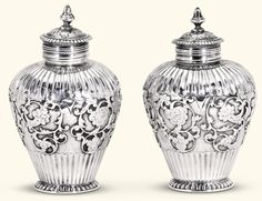 A pair of Dutch silver tea caddies, Amsterdam, ca.1725, conjoined maker's mark AZ, applied with scrolling foliage on matting, detachable covers.  The Gustav Leonhardt Collection, Property from the Bartolotti House, Amsterdam