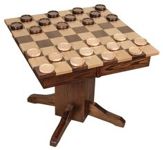 Amish Libby Game Table with Jumbo Sized Chess and Checker Game Pieces This fun Libby Game Table super sizes classic chess and checkers pieces. Solid wood construction throughout, this game table is sure to be a topic of conversation on game nights! #chessandcheckers #boardgames