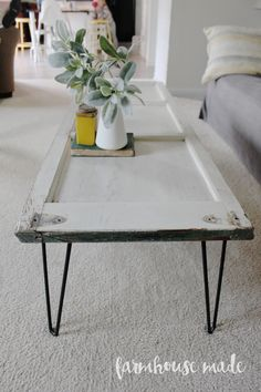 We decided to make this DIY coffee table using a salvaged shutter we got from a local shop, and some custom hairpin legs! Isn't it adorable!?