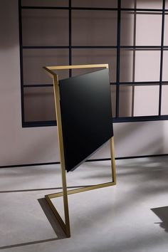 Loewe Bild 9 floor standing television with brass sculptural design - Television design that reaches beyond the screen. Interview with Charlie Cann, Head of Marketing at Loewe and Bodo Sperlein, Loewe's Creative Director.