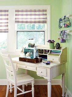 The Artist's Nook  Don't have an entire room to devote to your crafts projects? A narrow writing desk nestled into a corner of the living room can be the next-best solution. Here, short curtain rods hung on the wall above hold glass jars filled with supplies, and cheerful, checked Roman blinds finish the look.
