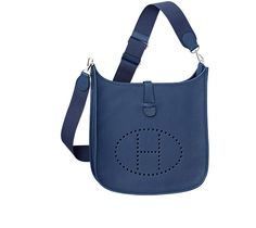 Evelyne III Bag in blue sapphire Clemence bull calfskin, closed with a leather flap and a snap closure, palladium-finish silver hardware, adjustable shoulder strap, flat outer rear pocket. Dimensions: l. 33 cm x h. 31 cm x d. 10 cm