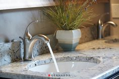 Bathroom faucet in brushed nickel with an undermount sink. GerhardsStore.com