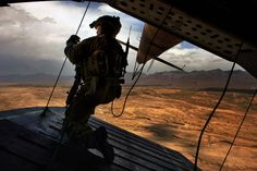 U.S. Air Force Tech. Sgt. Josh Martin, 438th Air Expeditionary Advisory Squadron, Mi-17 aerial gunner, provides rear security on a Mi-17 helicopter, Kabul, Afghanistan, May 31, 2014. Martin, a Rapid City, S.D. native, is deployed from the 55th Rescue Squadron, Davis Monthan Air Force Base, Ariz. The 438th AEAS and Afghan Air Force have combined efforts to train with about 300 Afghan commandos with the 8th Commandos Kandak. The training will enable Afghan helicopter aircrews to work…