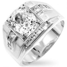 You are looking at a men's simulated diamond ring. This ring is 14K white gold bonded and features a iced frosted band on both sides. The ring features one raised large center oval simulated diamond, surrounded by a large number of smaller simulated d