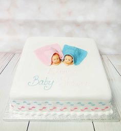 This Elegant and simple baby shower cake, cute little baby models that add that little extra to the cake.  #babyshowercake