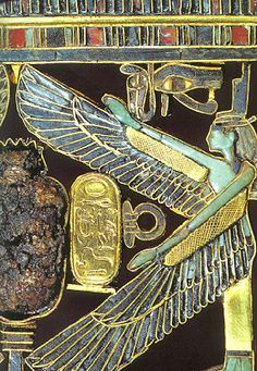 Detail of one of the two gold pendants of Pharaoh Psusennes chest with colored gemstones on the mummy of Psusennes were found. The goddess Isis spreads her wings in a protective gesture and giving birth to the cartouche with the name of the pharaoh.