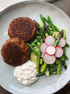 Vegetarian steaks on soy patty with haricot verts, asparagus, zucchini, soybeans, beetroot & tsatsiki