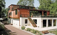 Container House - A couple builds a new home, repurposing a series of 11 shipping containers and an existing concrete foundation to maximal effect. Who Else Wants Simple Step-By-Step Plans To Design And Build A Container Home From Scratch? Building A Container Home, Container Buildings, Storage Container Homes, Container Architecture, Container House Design, Building A New Home, Container Home Plans, Container Van House, Natural Building