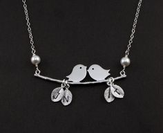 """Kissing Lovebirds Silver Necklace with white pearls """"Together II"""" 4 custom initials - Silver Jewelry ,Birthday, Family Nekclace. $36.50, via Etsy."""