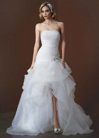 Strapless organza high-low ball gown is breathtaking with pickups and adorned with beaded detail at the dropped waist.