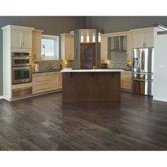 Shop Mohawk Dakota W x L Hawthorne Chestnut Embossed Laminate Wood Planks at Lowe's Canada. Find our selection of laminate flooring at the lowest price guaranteed with price match off. Mohawk Laminate Flooring, Laminate Flooring Colors, Best Flooring, Vinyl Plank Flooring, Wood Laminate, Wood Planks, Kitchen Flooring, Wood Flooring, Flooring Ideas