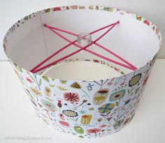 Ohoh Blog: DIY Lampshade , genius cheap and quick.... wrapping paper,  cardboard,  4 thin dowels,  paint string, gallon plastic bottle and 4 thumbtacks