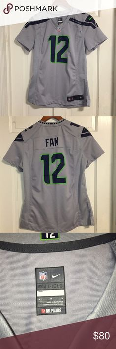 12 fan Seattle Seahawks jersey by Nike Womens medium. Authentic! PLEASE NO TRADES! NO P PA L! NO MRCRI! Open to offers but please remember to be reasonable. I have a bundle discount up right now but let me know if you wanna knock off a few more dollars. Bin:red Nike Tops