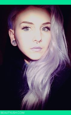 Lilac hair, septum piercing, ear gauges