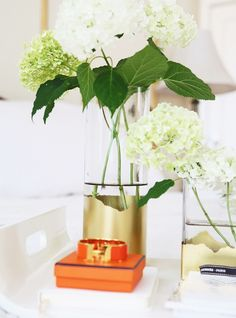 """Give your vases an """"edgy"""" look using torn newspaper and gold spray paint."""