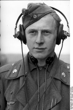 Young Panzersoldat in Russia, October 1941. Note his lapel Iron Cross ribbon and the voice gear. The throat mike did an excellent job in cutting surrounding noise and allowing for clear monophonic communication. The inside of a Panzer was a permanent megaphone of brutal noise.