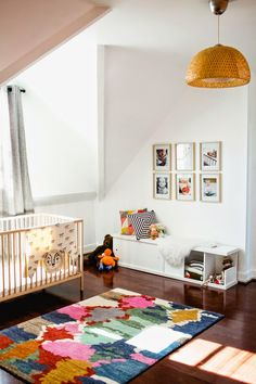 Sometimes all the bright color in a nursery can come from one source. Using a rug that is multicolored and patterned makes for a chic gender-neutral nursery solution perfect for those chubby little knees - Baby Nursery Today Nursery Rugs, Girl Nursery, Nursery Decor, Nursery Ideas, Bedroom Decor, Bedroom Ideas, Ikea Nursery, Nautical Nursery, Playroom Ideas