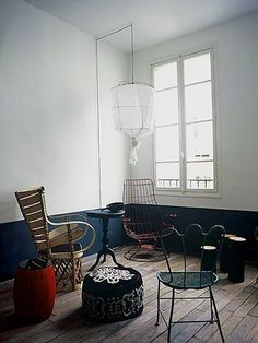 Paola Navone's apartment, Paris (I love how everything has great line. The structure of everything has quite a presence.)
