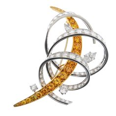 CARTIER - a coloured diamond and diamond brooch. Designed as a graduated fancy 'yellow' brilliant