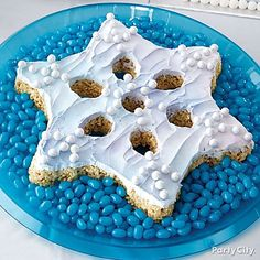"Flurry over to our Frozen Snowflake Rice Cereal Cake how-to for all the details! This delicious cake will be gone faster than you can say ""Let it go!"""