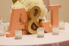 Bride and Groom table decor - DIY lace covered votives created by my bridesmaids :)