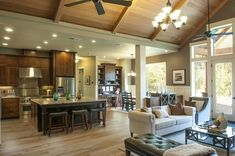 Love the relationship between great room, kitchen, and nook.vaulted ceiling. <3